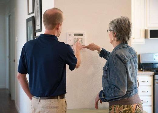 Instructing Customer on how to use home security system.