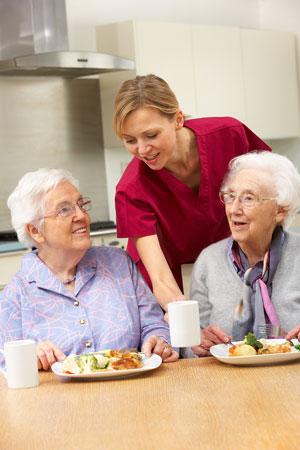 elderly people being served food
