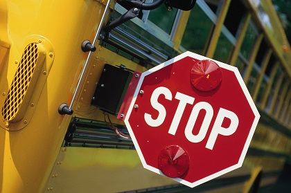 School Safety Sign on Bus