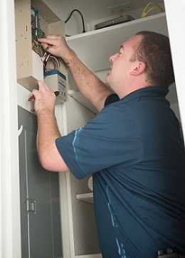 Alarm Tech working on a Security System