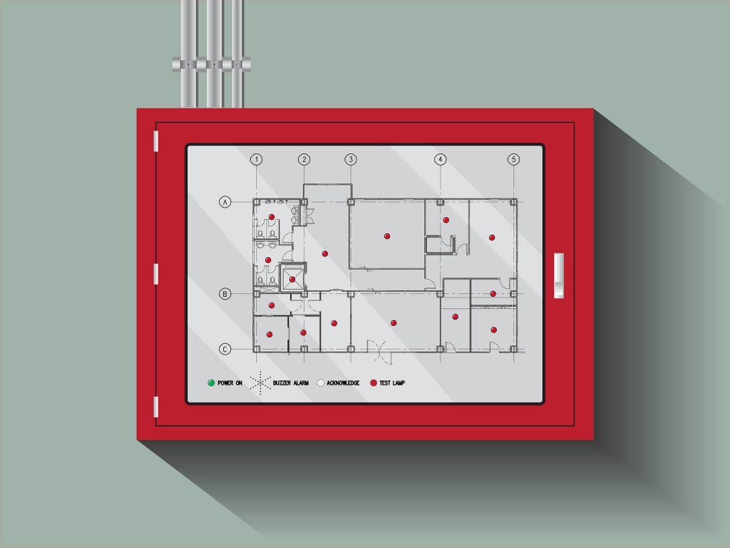 a commercial fire alarm system panel with building layout displayed mounted on a wall